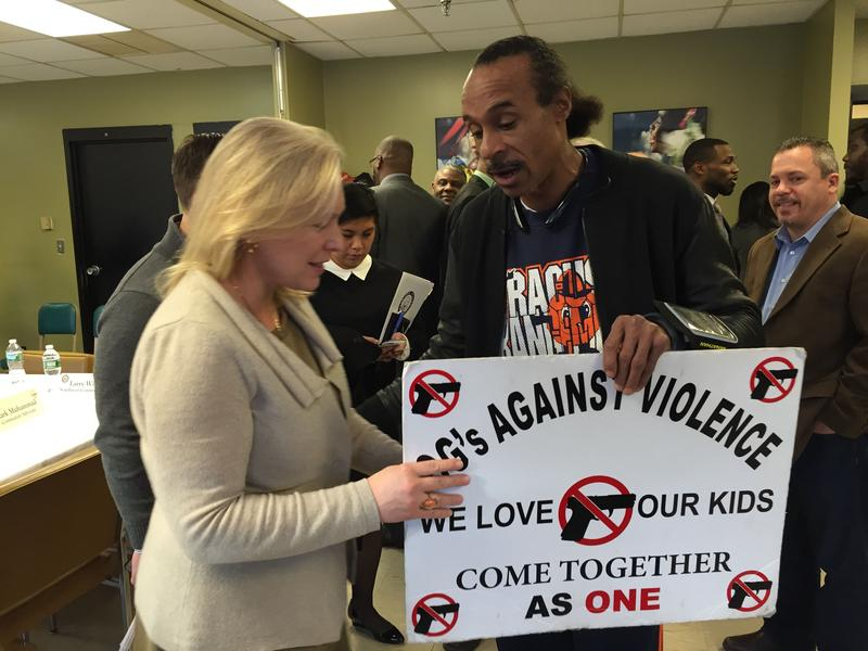 Sen. Kristen Gillibrand with anti-gun violence activists in Syracuse.