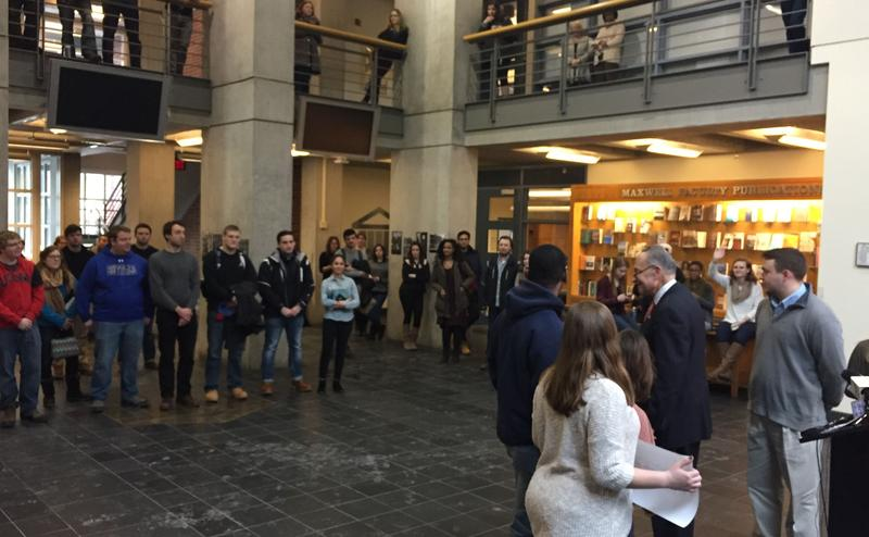 At Syracuse University's Eggers Hall, Sen. Charles Schumer asked students to lobby for a legislative proposal to make college more affordable.