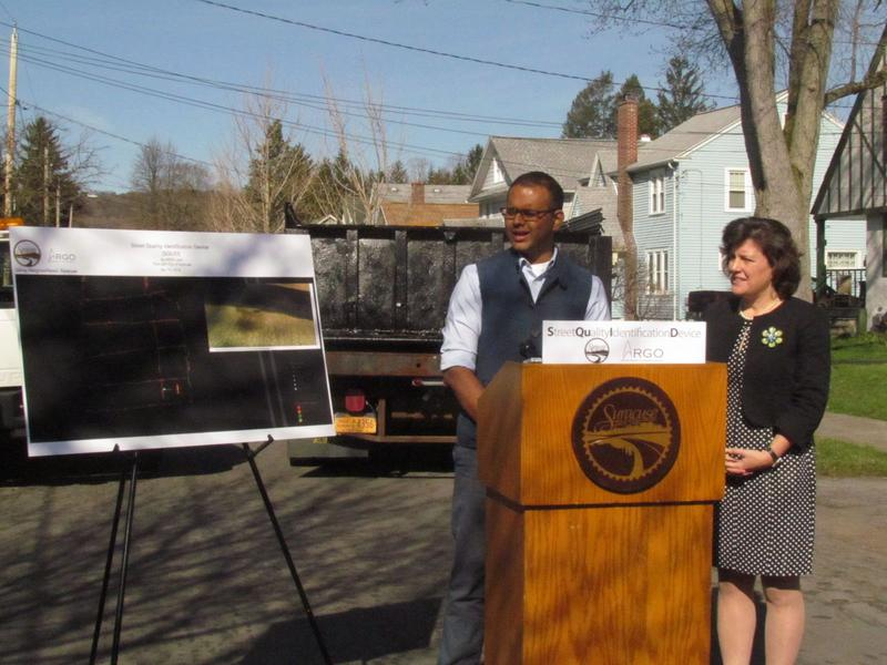 Varun Adibhatla, developer of SQUID technology, and Syracuse Mayor Stephanie Miner, discussing the city's use of the device to measure road quality.