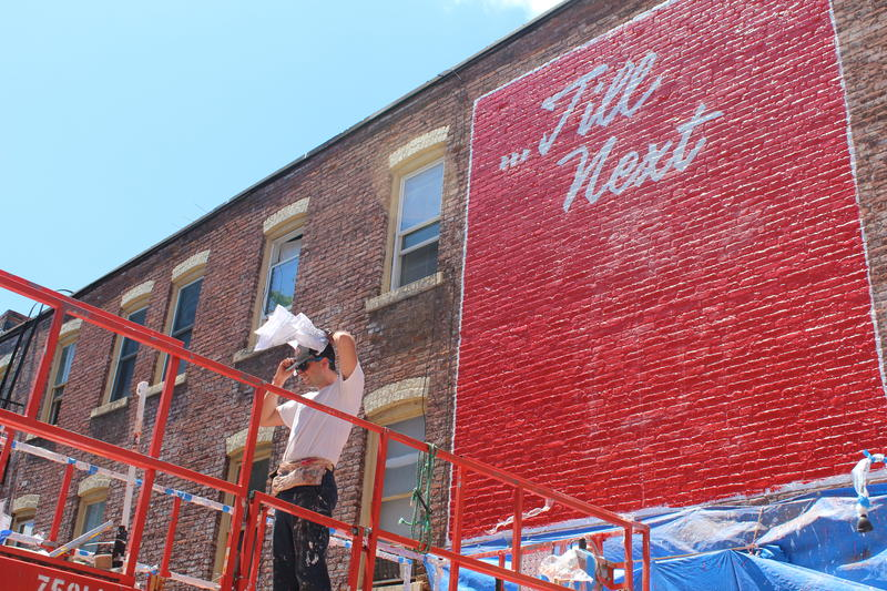Artist Jon Bocksel gets ready to continue work on his mural in downtown Syracuse.