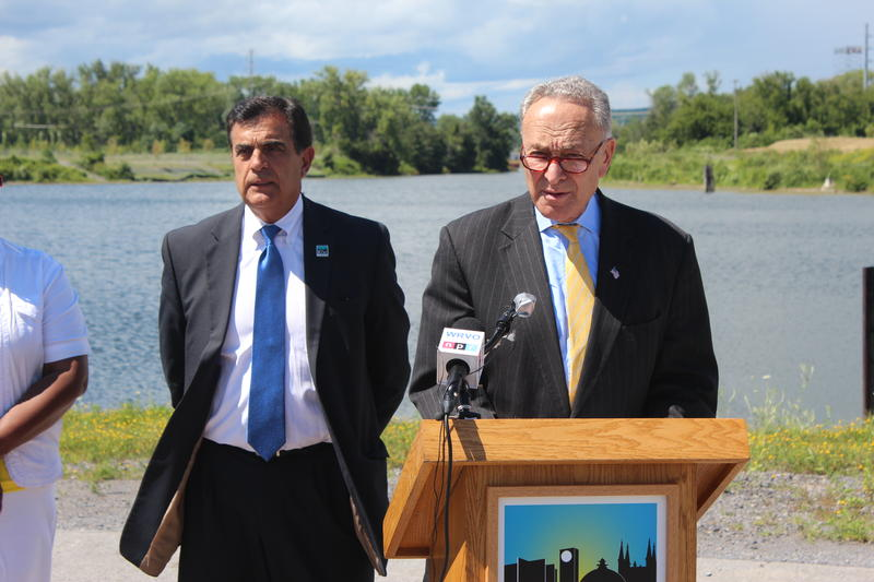 Democratic New York Sen. Charles Schumer (right) and Utica Mayor Robert Palmieri at Harbor Point in Utica.