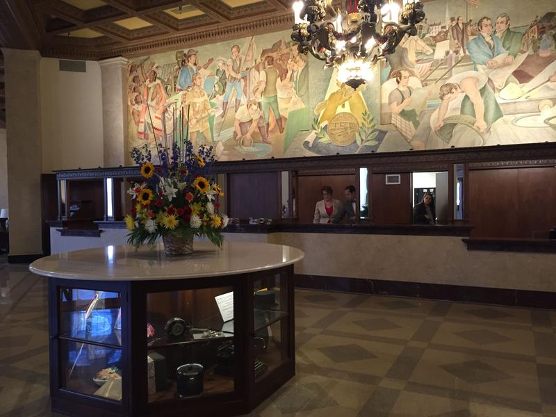 The front desk of the Marriott Syracuse Downtown, with a restored mural from the 1940s.