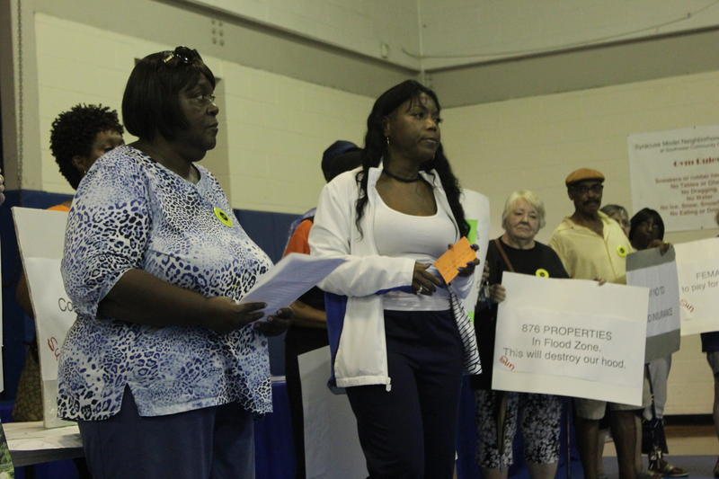 Joanne Stevens (left) and Tecia Evans (center) protest at the Southwest Community Center.
