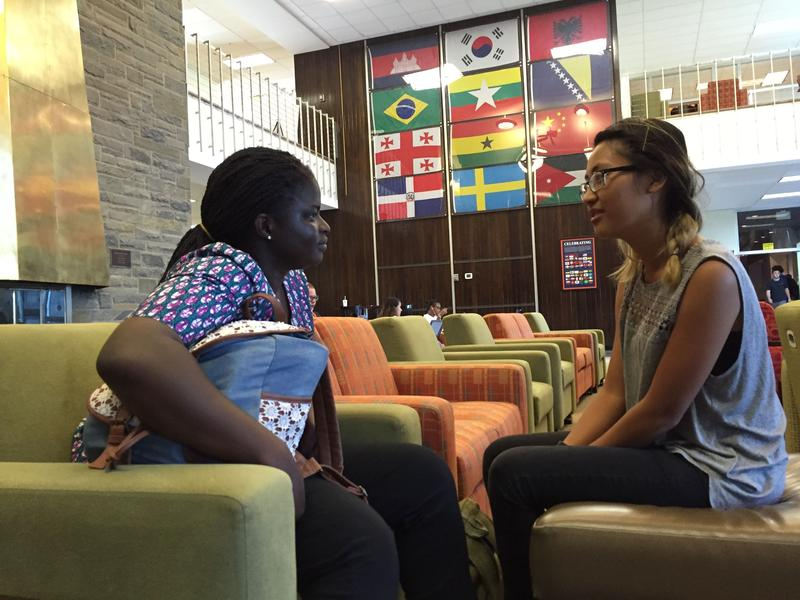 Utica College students Marjorie Tetteh, left, and Rutha Kyi say the school's tuition reset, which lowered annual undergrate rates by $15,000, has not beneffited everyone equally.