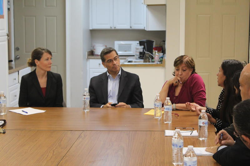 Colleen Deacon (left) with Rep. Xavier Becerra (center) at the Spanish Action League in Syracuse.