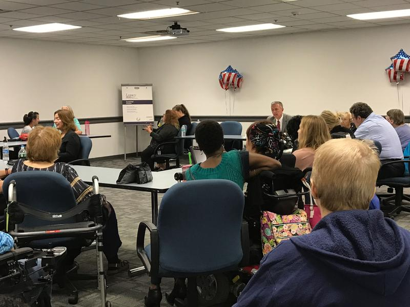 A candidate forum on disabled issues was held in Syracuse Thursday. Rep. John Katko can be seen in the back right, facing the camera.