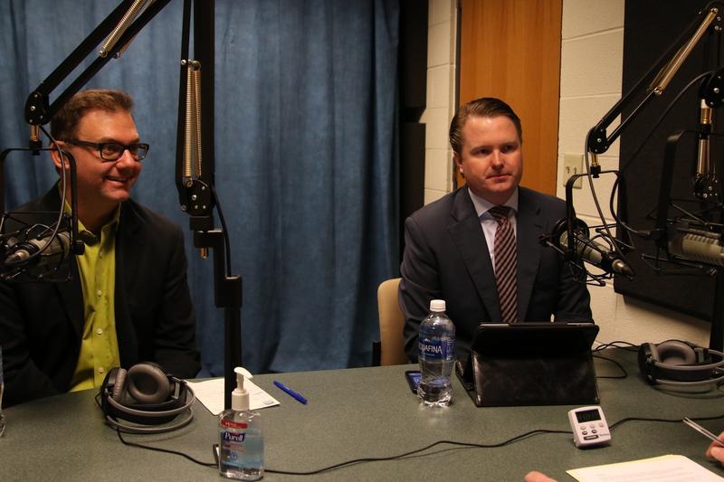 Syracuse University professor Chris Faricy, left, and Oswego County Clerk Michael Backus, right