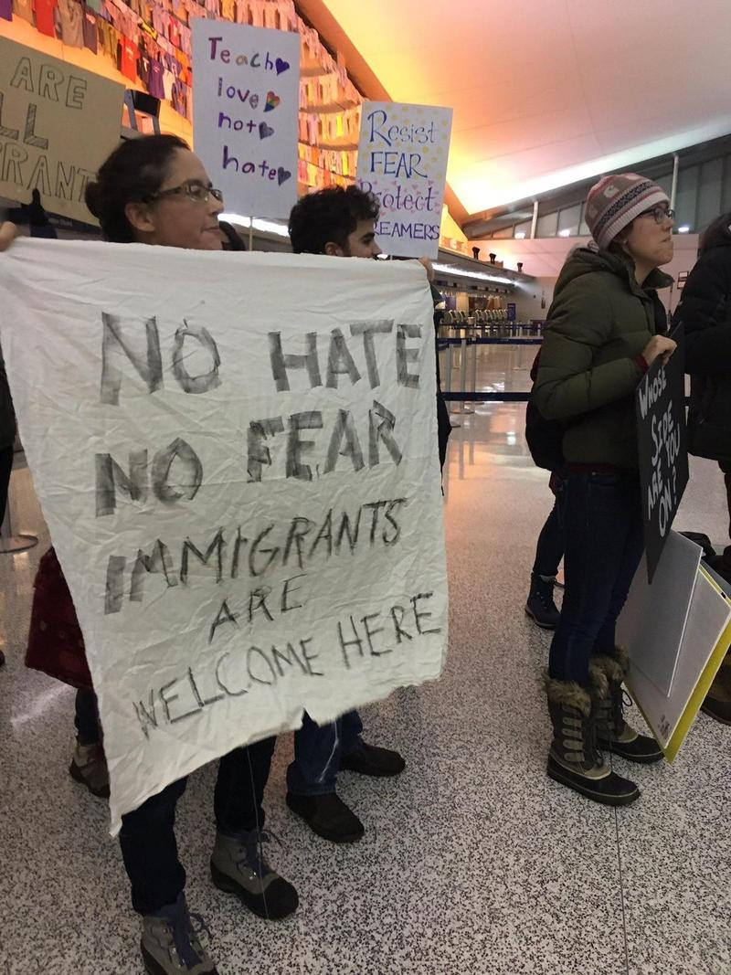 Activists express their support for immigrants during a recent local rally. A study conducted by several academic partners including a UB professor finds no connection between immigration and rising crime rates.