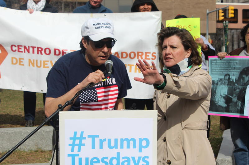 Syracuse Mayor Stephanie Miner subdues the crowd to let Trump supporter Randy Potter speak.