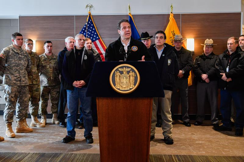 Gov. Andrew Cuomo, flanked by Oneida County Executive Anthony Picente on his left and Utica Mayor Robert Palmieri, discuss the state's response to the massive snowstorm that blanketed the Mohawk Valley and other areas of upstate.