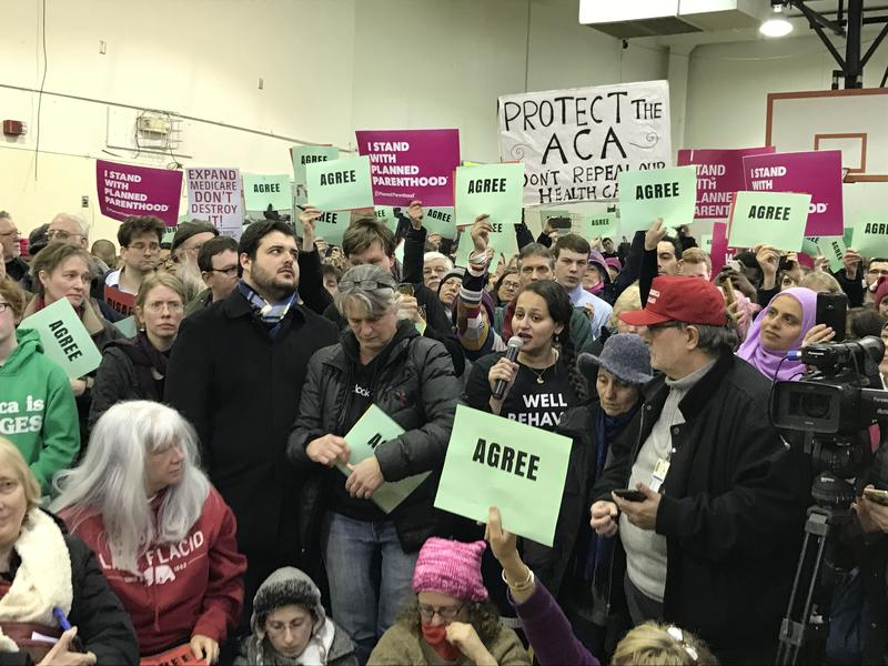 Walaa Mararem-Horan defends the healthcare services of Planned Parenthood at a town hall meeting with Rep. Tom Reed (R-Corning). Planned Parenthood could lose federal funding under a Republican bill to replace the Affordable Care Act.