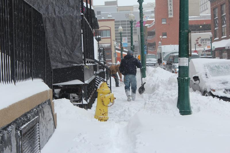 Snow covered sidewalks in Syracuse.