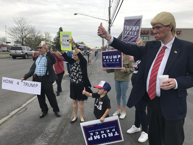 Supporters of President Donald Trump commemorate his first 100 days in office with a rally outside of the Onondaga County Republican Party headquarters in Syracuse.