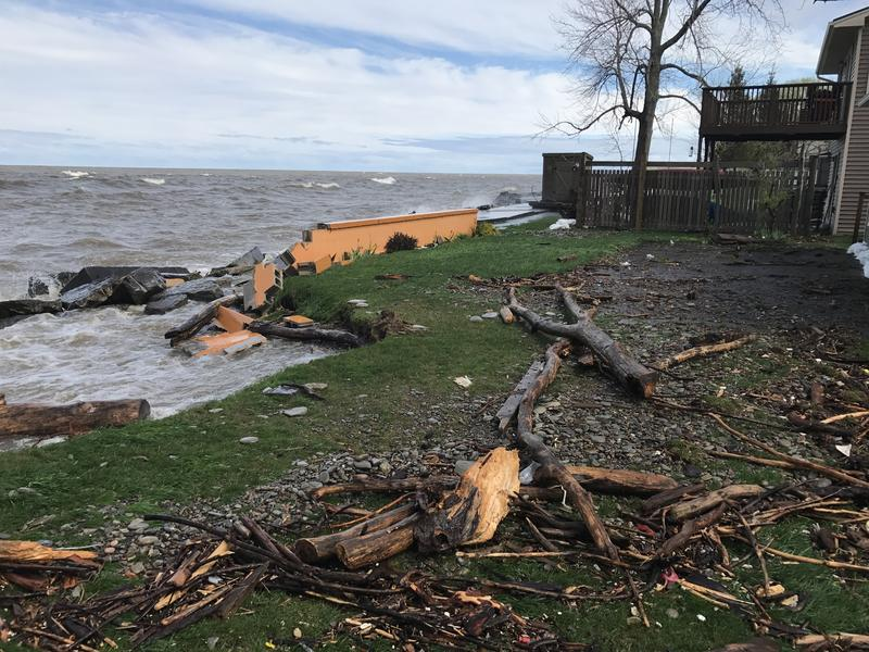 High water levels in Lake Ontario have eroded part of the coastline in Oswego, ripping apart one resident's break wall.