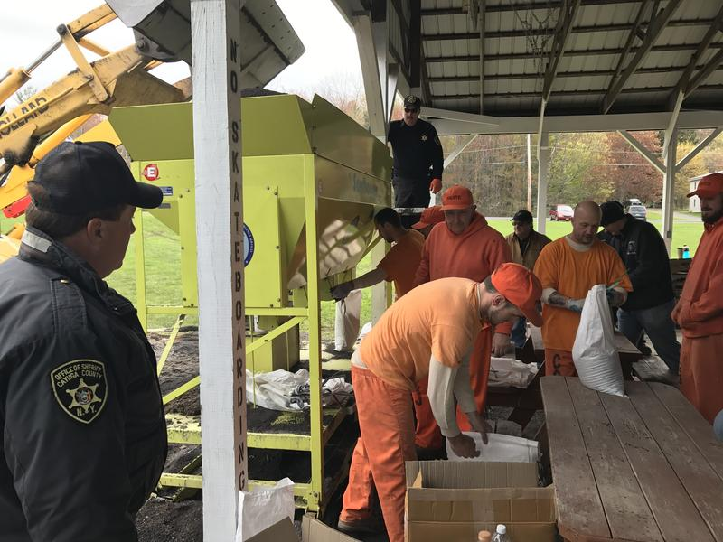 Inmates from the Cayuga County Jail are helping the village of Fair Haven fill sandbags as flooding threatens nearby homes.