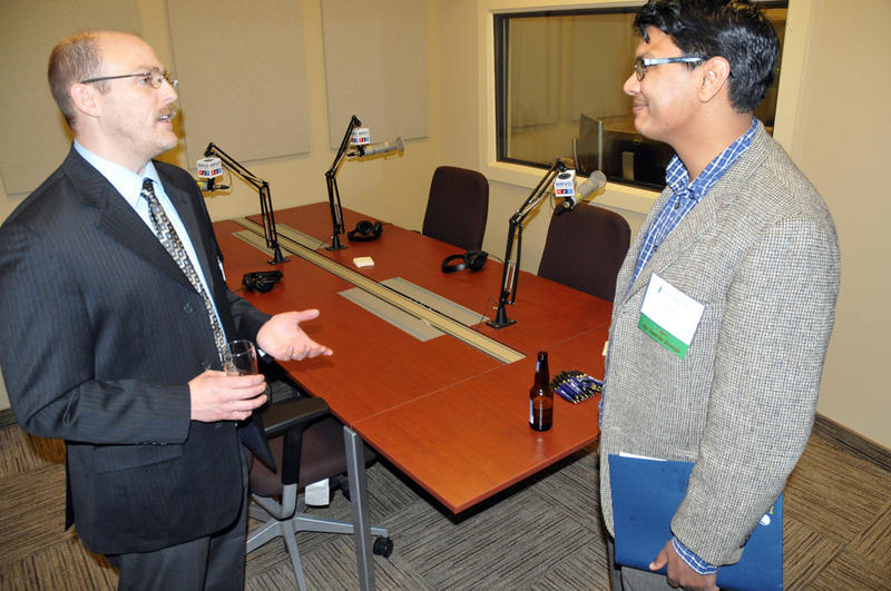 "Jeff Windsor (left), our chief engineer, speaking with a guest at the reception in our talk studio at the SUNY Oswego Metro Center. It's the same space in which we tape ""Take Care,"" our health and wellness show, each week."