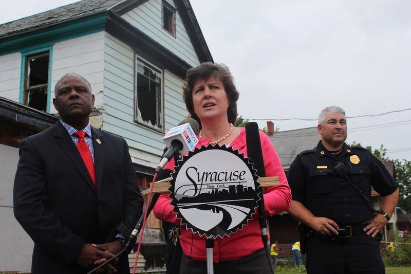 Syracuse Mayor Stephanie Miner in 2015, standing in front of an abandoned home on the city's west side.