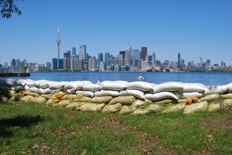 Sandbags line the shore of Ward's Island, facing the Toronto skyline.