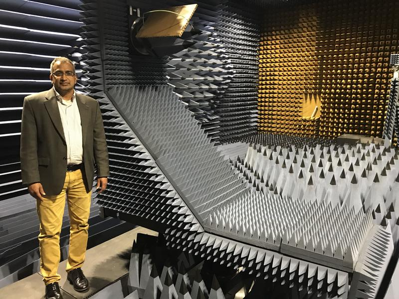 Patanjali Parimi, director of SUNY Oswego's Advanced Wireless Systems Research Center, stands inside the college's anechoic chamber where he is developing a device to improve the speed and security of wireless data transmissions.