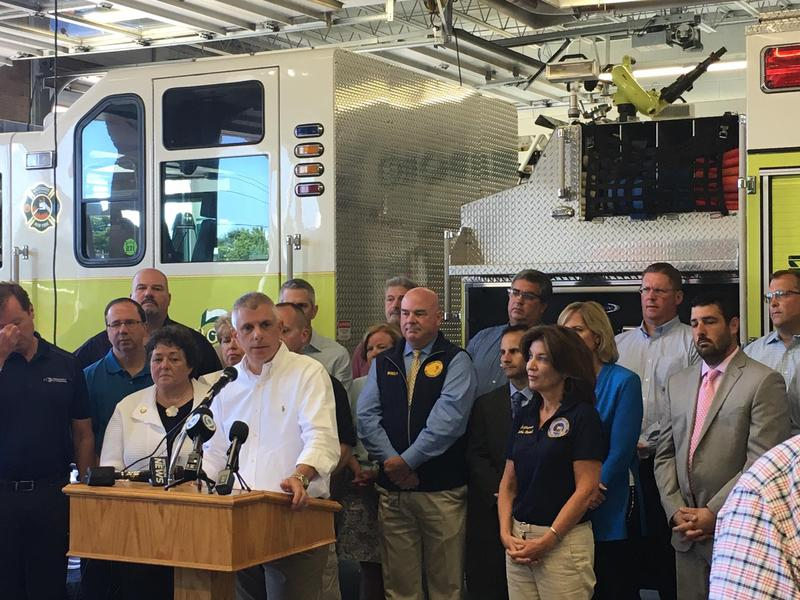 Oneida County Executive Anthony Picente and New York Lt. Gov. Kathy Hochul, right, announce recovery efforts to help homeowners affected by last weekend's flash floods.