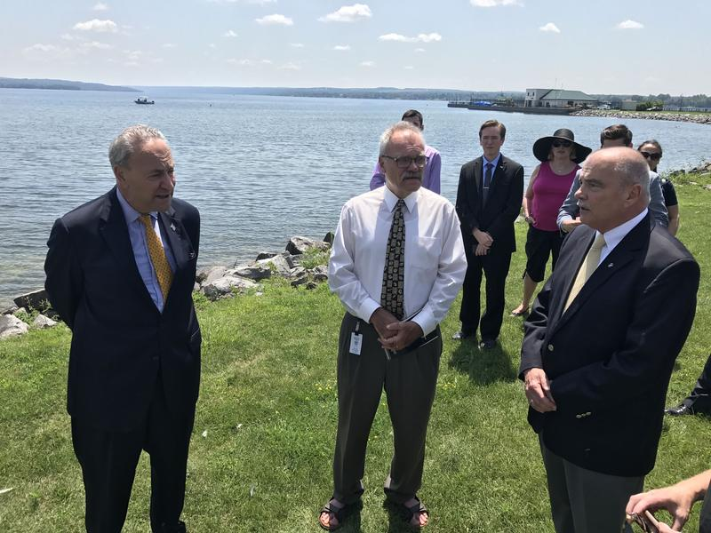 Sen. Charles Schumer, left, talks with Cayuga County Legislature Chairman Kevin Batman, middle, and Auburn Mayor Michael Quill about the toxins issue in Owasco Lake.