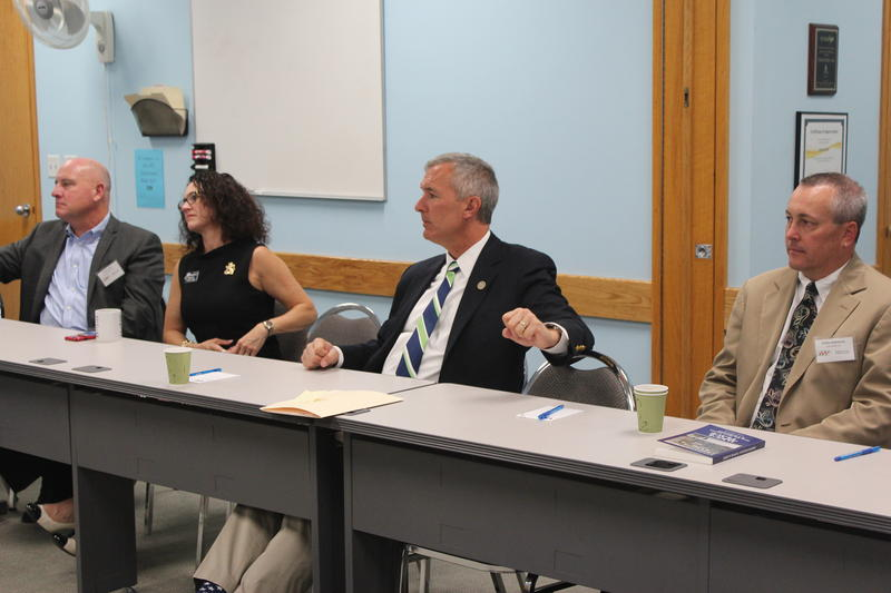 Rep. John Katko (center) at a manufacturing round table in East Syracuse.