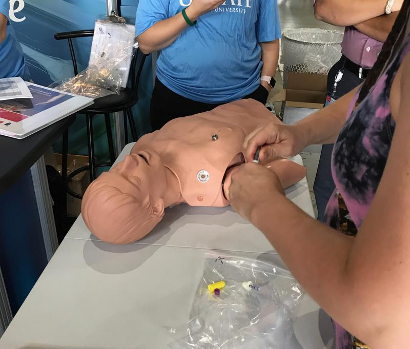 Visitors to the New York State Fair can practice administering the opioid overdose drug Narcan to a dummy