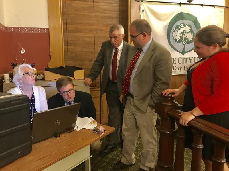 Members of the Oswego Common Council work with City Chamberlain Deborah Coad, left, on a budget amendment.
