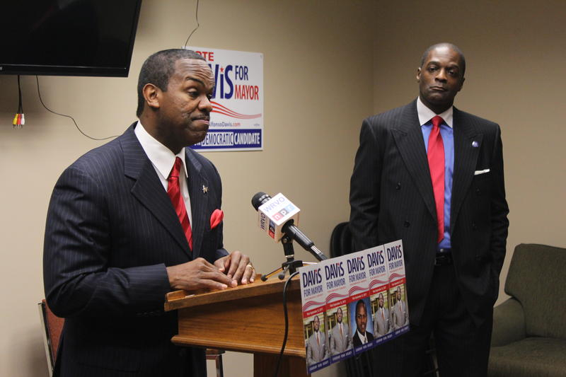 Democrat Alfonso Davis (left) tells his supporters to write him in the primary ballot on Tuesday.