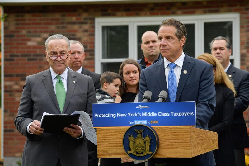 Sen. Charles Schumer (D-NY), left, and Gov. Andrew Cuomo speak at a home near Albany Monday