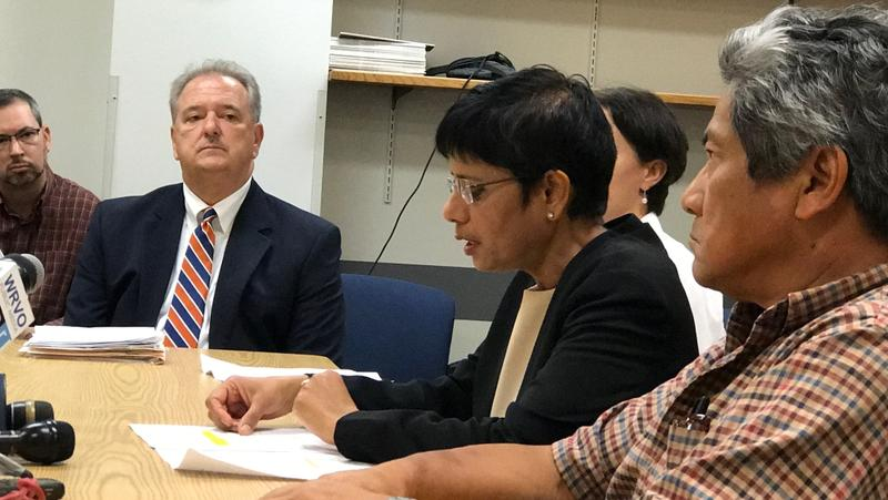 Onondaga County Health Commissioner Dr. Indu Gupta, center, speaks to the media Wednesday about an outbreak of mumps on the Syracuse University campus