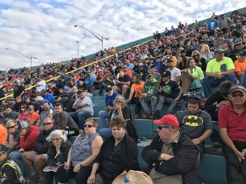 Fans at the Oswego Speedway watch the 46th annual SuperDIRT Week race.