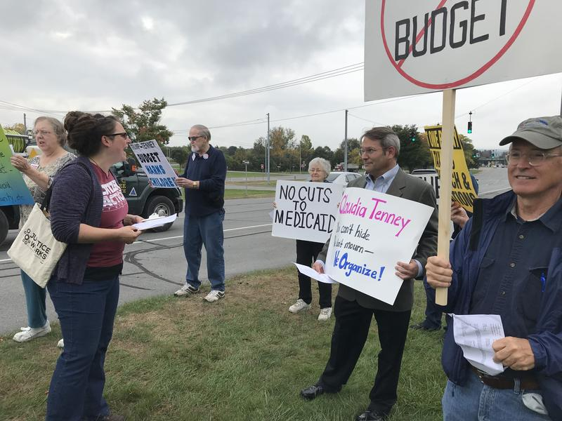 Protesters demonstrate outside of Mohawk Valley Rep. Claudia Tenney's office after she voted for a GOP bill that would cut funding for entitlement programs and other services for low-moderate income Americans.