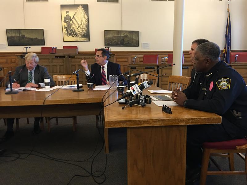 Syracuse Police Chief Frank Fowler (right) at the Syracuse Common Council.