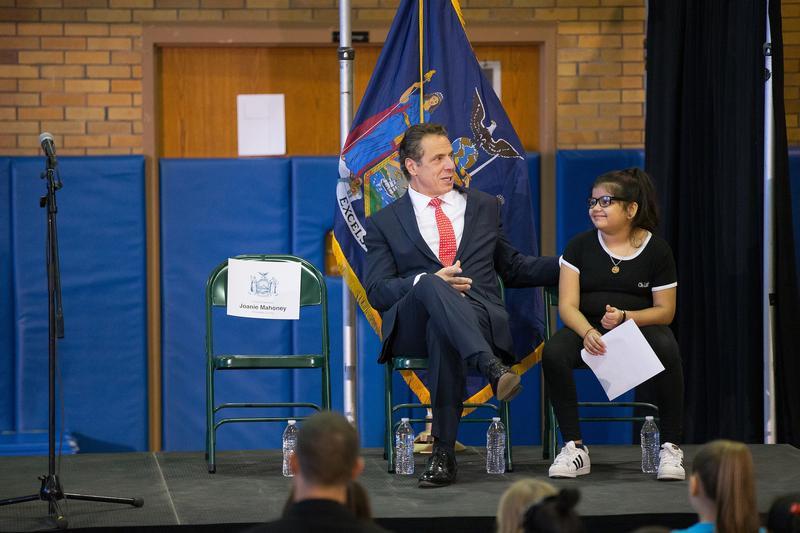 Gov. Andrew Cuomo sits with LeMoyne Elementary 5th grader Pratima Neopaney Tuesday
