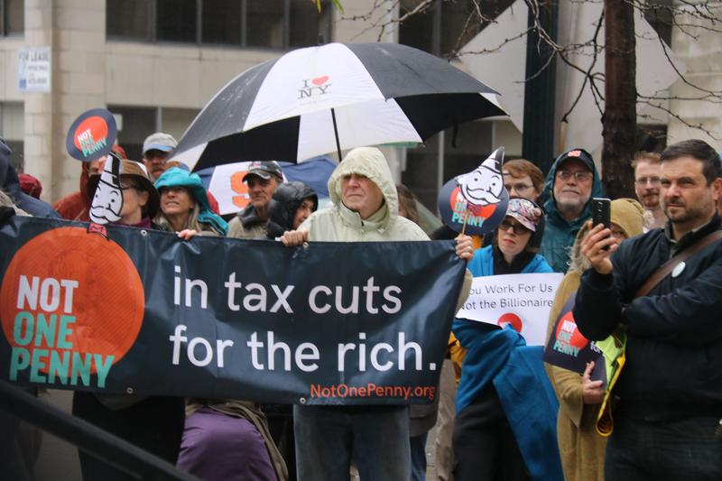 In Syracuse, protesters demonstrated before a Small Business Administration meeting to deride the proposed tax overhaul that Republican members of Congress are working to pass.