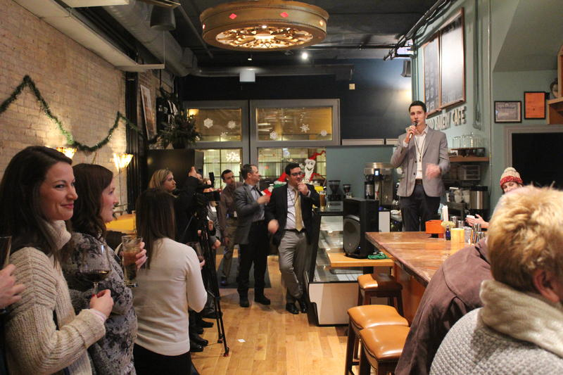 """Eric Ennis of 40 Below gives a speech at the """"Come Home to Syracuse"""" event."""