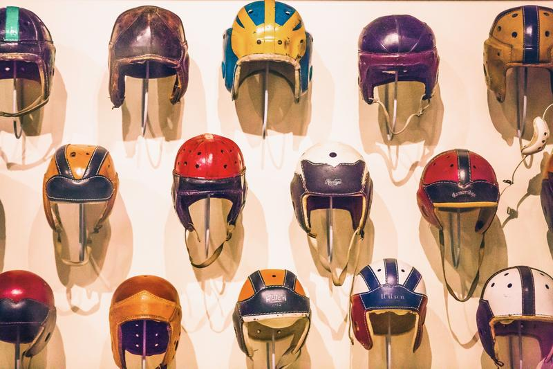 Early football helmets had no facemask and were made of leather, which did not provide much protection