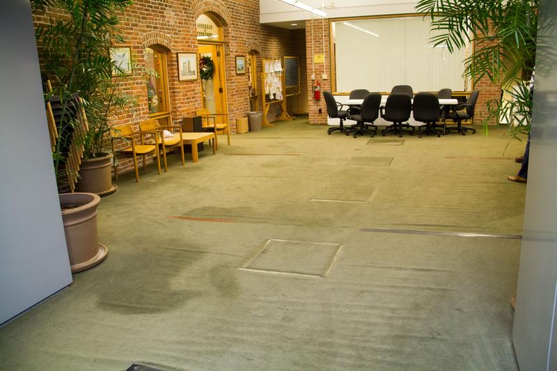 The carpets on the third floor of Oswego City Hall are frequently soaked due to a leaking roof.