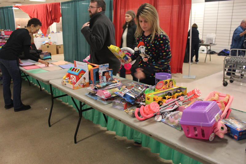 Volunteers sort through toys for the Salvation Army's Christmas Bureau Distribution Day.