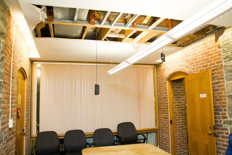 The ceiling in the Oswego City Hall conference room collapsed this year due to a leaking roof. The building from 1870 is getting state money for renovations.