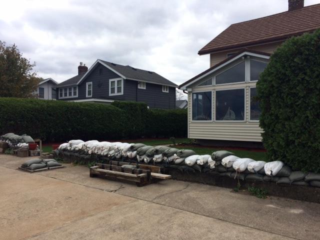 Sandbags are lined up along Douglas Dobson's home along the Lake Ontario shoreline