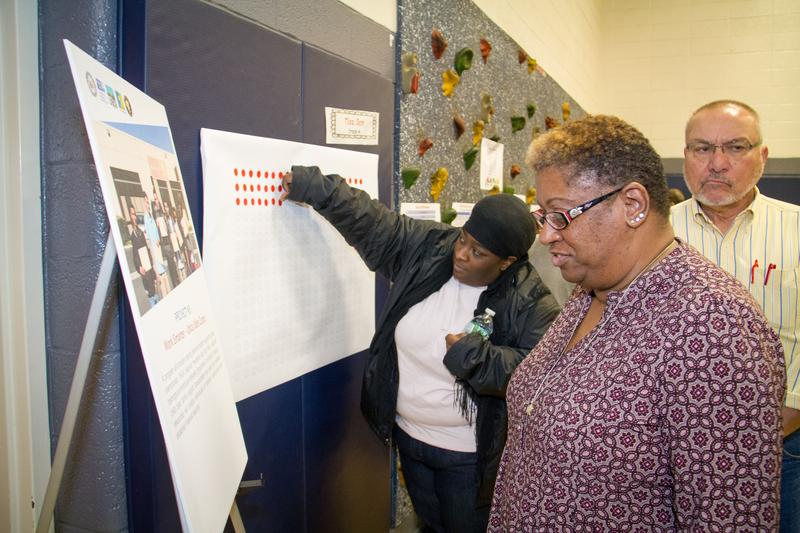 Utica residents vote for which projects they want to fund as part of a poverty reduction initiative.