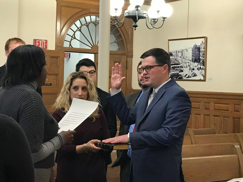The newest member of the Syracuse Common Council, Michael Greene, is sworn into office.
