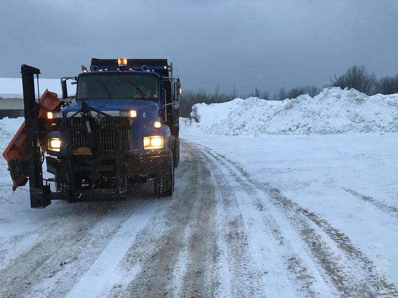 An Oswego snow plow at one of the city's snowbank reservoirs. Oswego had to open a third reservoir after excessive snowfall this winter.