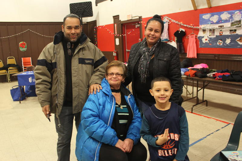 At the YWCA, Dorothy Huertas (center, sitting) of Syracuse is with her grandson Eduardo Huertas III (front), and Jorge Malave and his wife Zaida stand behind them.