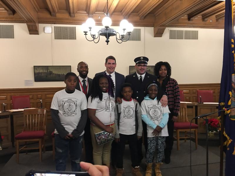 Syracuse Mayor Ben Walsh (center, left), Fire Chief Michael Monds (center,right) with students from Dr. King Elementary School.