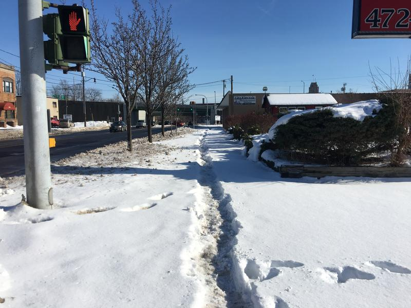 An unshoveled sidewalk on West Genesee St. in Syracuse in January.