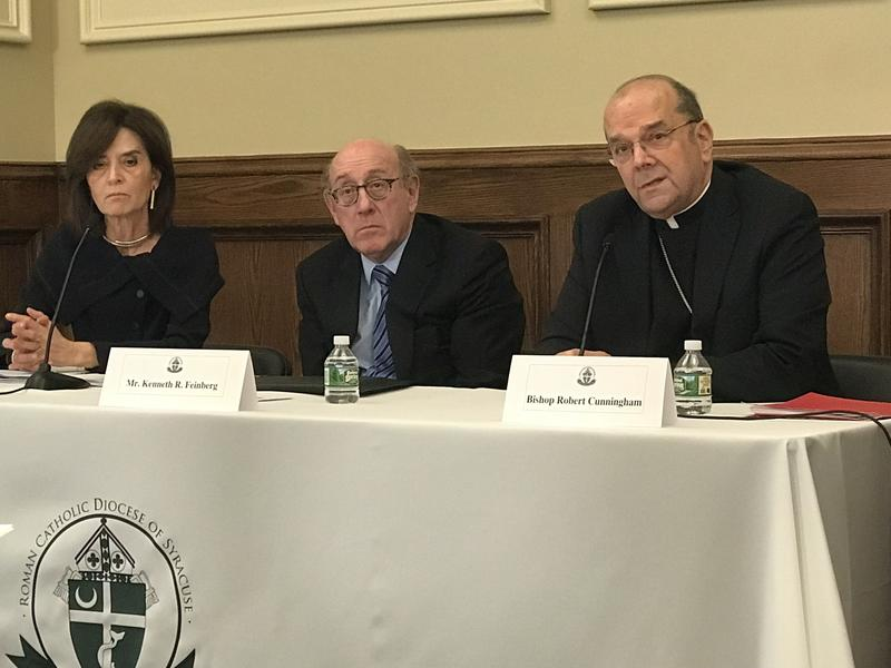 Syracuse Bishop Robert Cunningham, right, discusses a new program in the diocese to make amends to victims of clergy abuse.