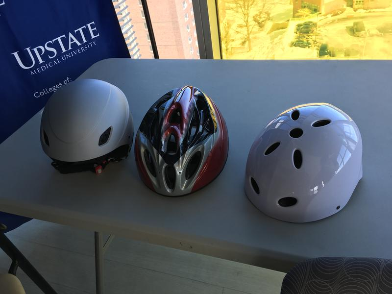 From left to right, a ski helmet, a bike helmet and a multi-sport helmet (not recommended for skiing or biking).